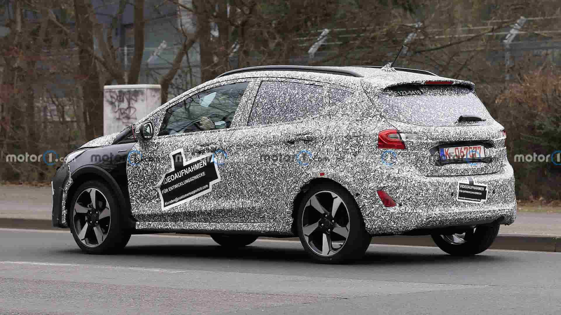 ford fiesta facelift first spy photo rear three quarters 1