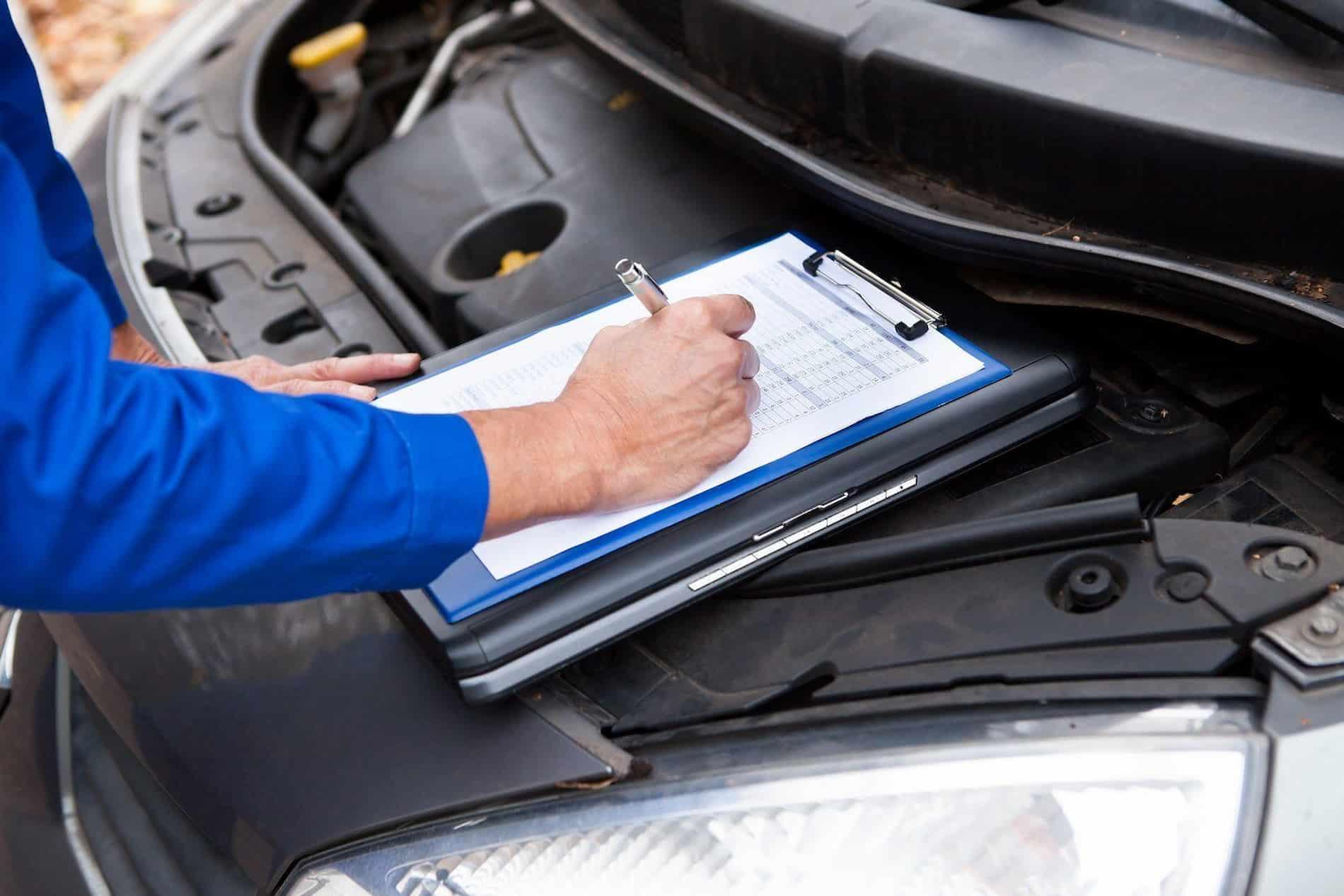 bigstock mechanic maintaining car recor 64059901